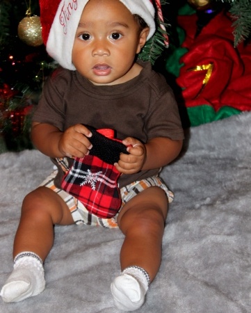 African American baby under Christmas tree Stock Photo