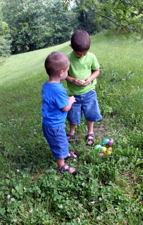 Two little boys findng Easter Eggs