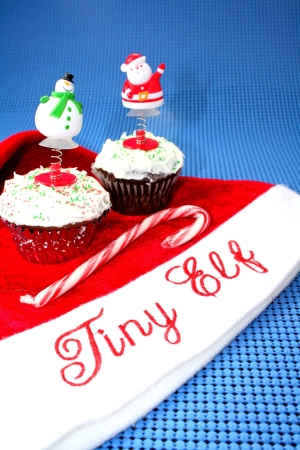 Santa hat with two cupcakes decorated