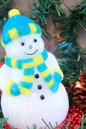 Close up of snowman decoration with garland, beads and Christmas lights Stock Photo