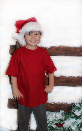 Little boy in red shirt at Christmas Stock Photo
