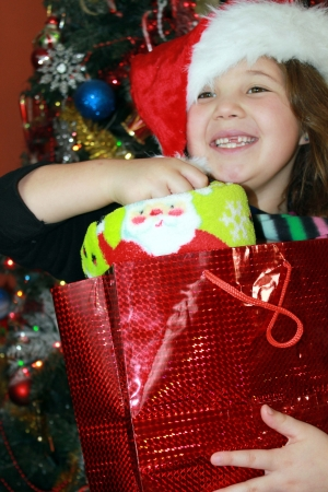 Cute little girl with Christmas gifts photo