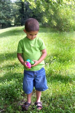 Little boy getting Easter Eggs