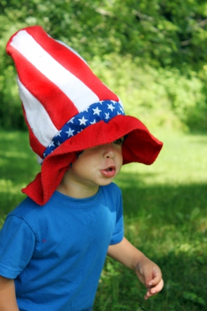 4th of July hat on little boy Stock Photo
