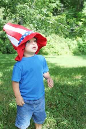 Baby boy wearing 4th of July hat Archivio Fotografico