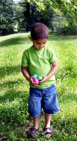 Little boy with Easter Eggs in his hands