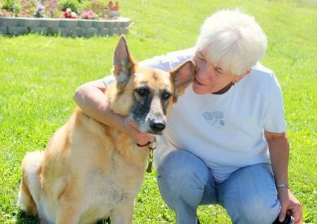 Senior woman with her german shepherd dog photo