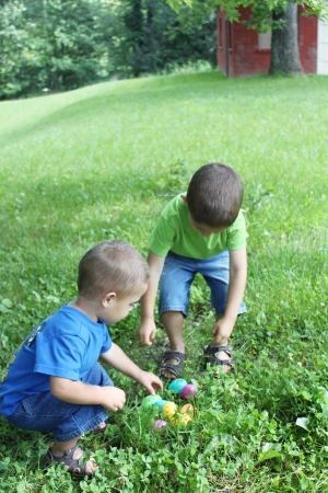 Two little boys finding Easter eggs Stock Photo