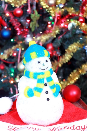 Snowman decoration under Christmas tree Stock Photo