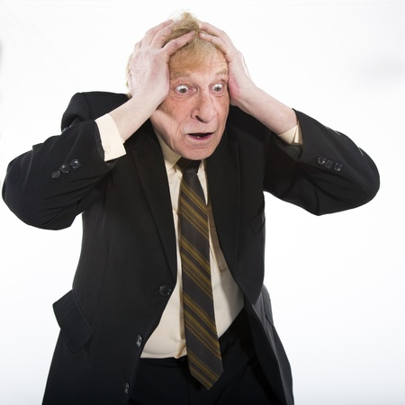 Stressed old business man white background photo