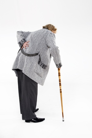 Full length portrait of old man with a cane