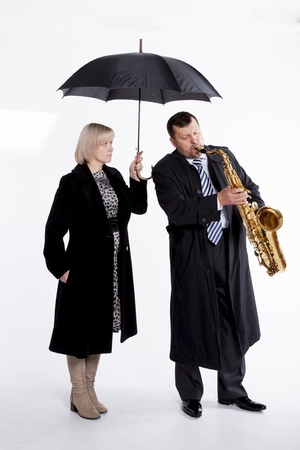 lone musician and hand girl with an umbrella                 photo