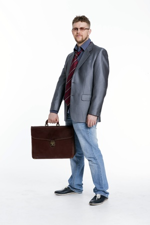Young business man on his way to work, rest, talking, sitting, reflects photo