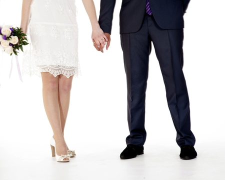 Portrait of Caucasian groom and Asian bride young and perky