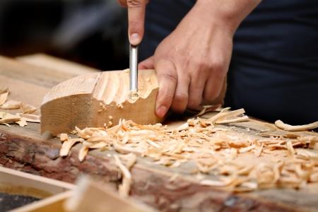 Old woodcarver work in the workshop