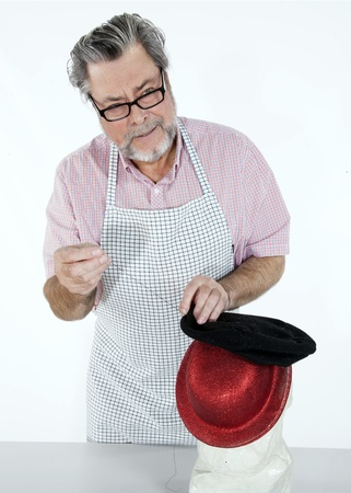 taylor: Tailor working at home with a hat focuses on hands Stock Photo