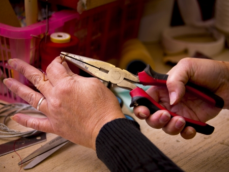 hit tech: Woman working with pliers and other tools Stock Photo