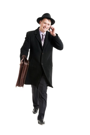 diplomat: Businessman with the diplomat talking on the phone Stock Photo