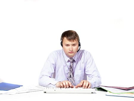 inadequate: Emotional man working on the computer and with documents Stock Photo