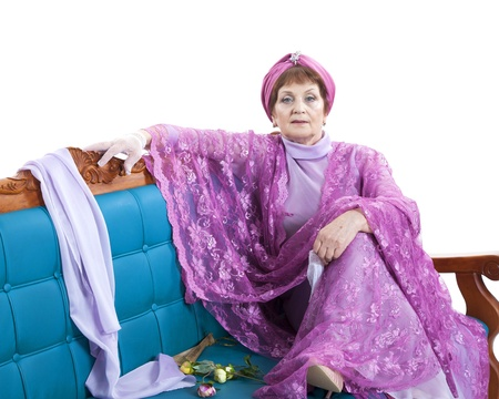 cane sofa: Woman in violet dress sitting on the sofa