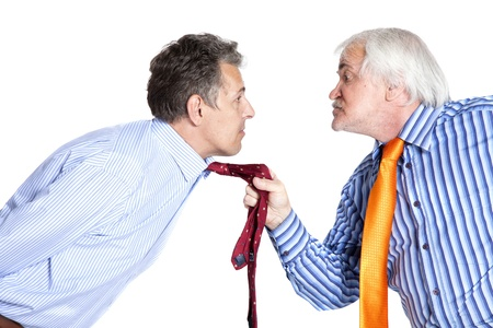 businessman pulling a tie to younger man on white background photo