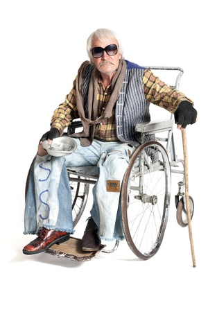 castaway:  homeless man in a wheelchair asking for money Stock Photo