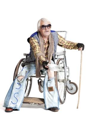 wellfare:  homeless man in a wheelchair asking for money Stock Photo