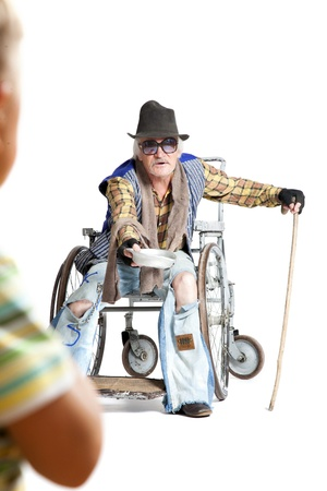 homeless man in a wheelchair asking for money photo
