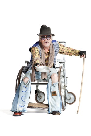 homeless man in a wheelchair asking for money Stock Photo