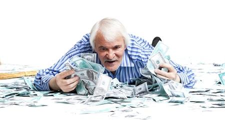 elderly man lying in the money on a white background Banco de Imagens