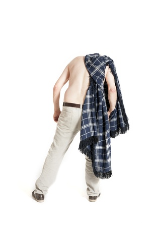 Man with a plaid turned back and looking down on a white background photo