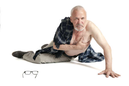 disorganization: Upset man covered with blanket lying on on the floor on white background
