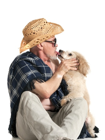 furrow: Man in a hat sitting with a poodle on white background