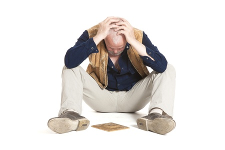 man sits on the floor with gilded fretwork on white background