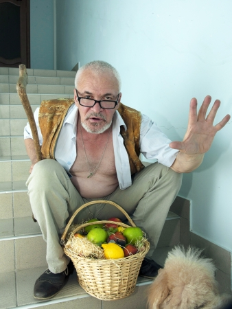 Emotional man with a dog and a basket of fruit photo