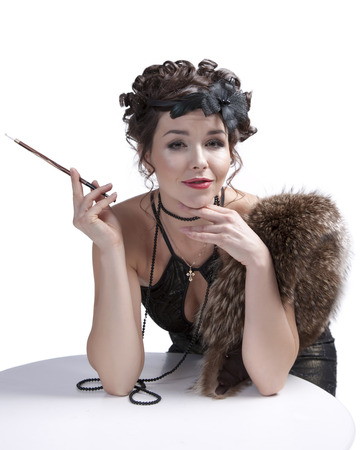 emotional woman in retro style with mouthpiece in the studio photo
