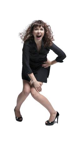 vestido corto: Mujer emocional posando en estudio, vistiendo traje corto.