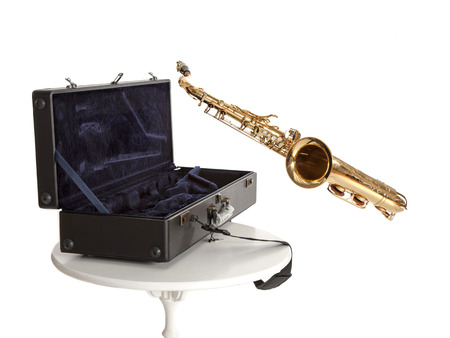 saxophone and box isolated on white photo