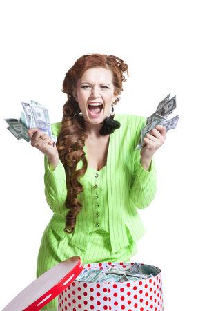 白のボックスにお金を持つ驚く少女