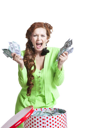 surprised young girl with money in a box on a white