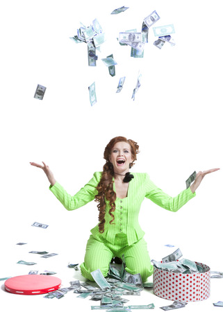 Happy woman throwing money on a white photo