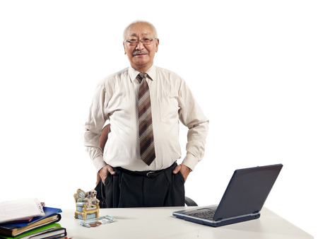 mature businessman at table with laptop computer photo