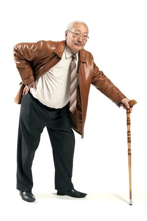 mature man with cane isolated on white  photo
