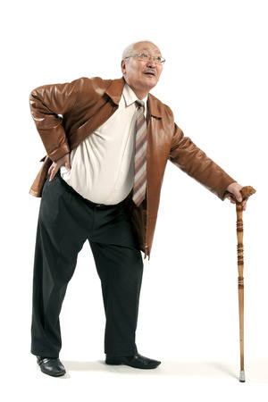 mature man with cane isolated on white