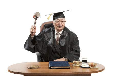banging: mature man judge at table isolated on white  Stock Photo