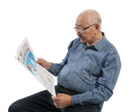 mature man reads newspaper isolated on white
