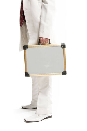 businessman in a white suit with case photo
