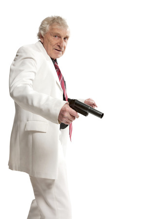 elderly man with gun on white  photo