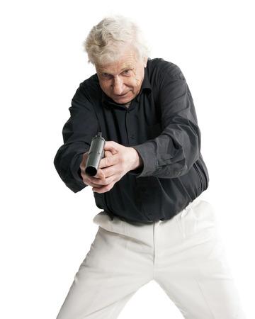 elderly man with gun on white background Stock Photo