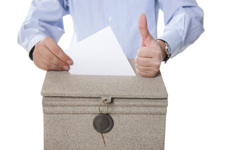 man putting letter in mailbox,showing thumbs up gesture on white background photo